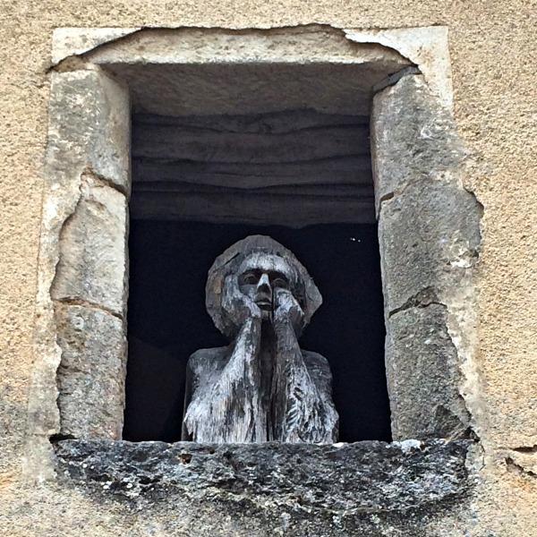 wooden window sculpture